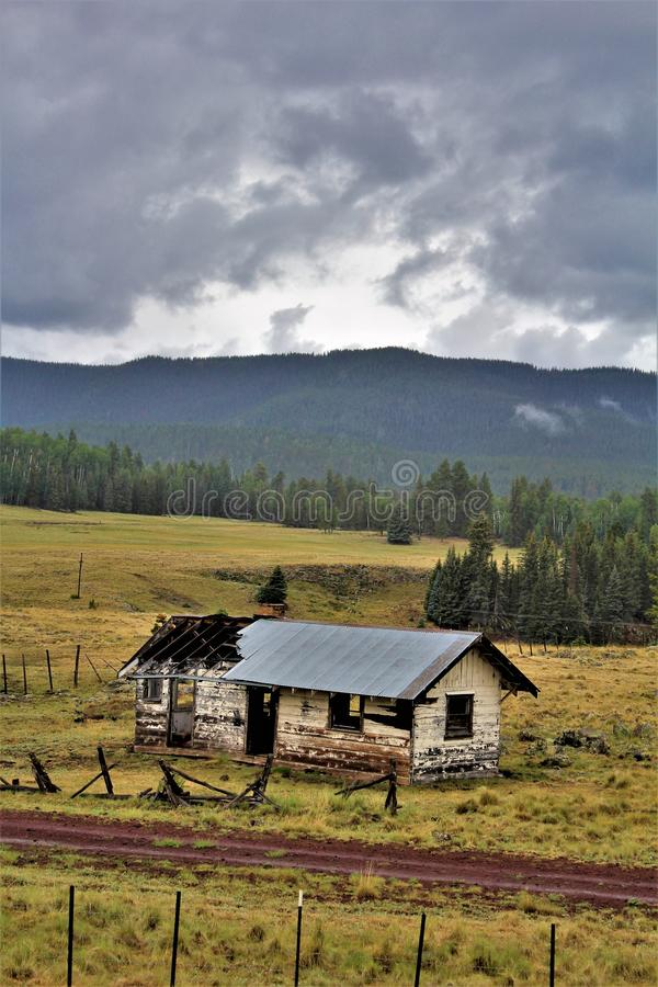 White Mountains Apache Reservation landscape, Arizona, United States. Scenic landscape view of an abandoned house at the White Mountains Apache Tribe of the Fort royalty free stock images