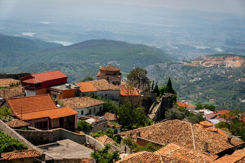 Scenic landscape view of the the old town of Kruja on a mountain slope in Albania with the hills in the background. royalty free stock photo