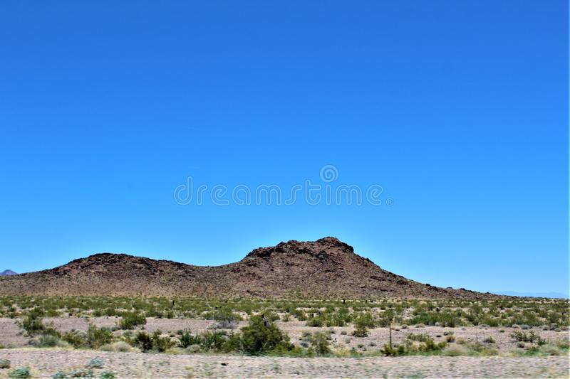 Scenic landscape view Phoenix to Las Vegas, Arizona, United States. Roadside scenic landscape view of vegetation, rocks and mountains on route US-93 north royalty free stock images