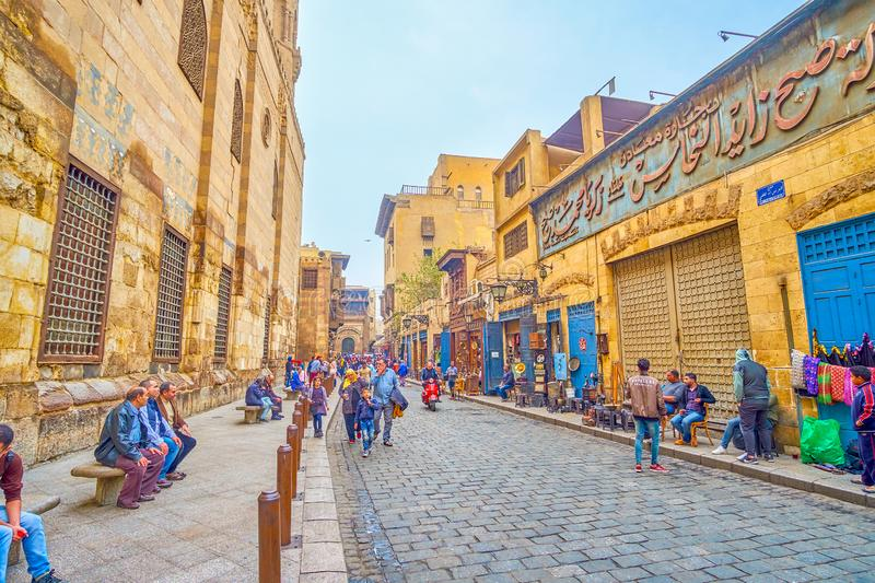 The scenic medieval Egyptian street, Cairo. CAIRO, EGYPT - DECEMBER 20, 2017: The Al-Muizz street ant its surrounding buildings are the symbol of medieval royalty free stock photos