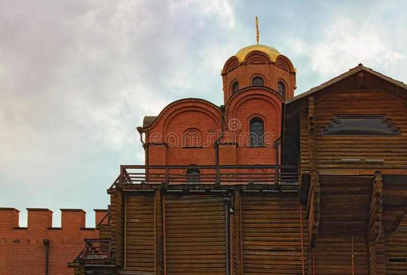 Scenic morning view of Church with golden dome on the top of the ancient Golden Gate. It was the main gate in ancient Kyiv stock photo
