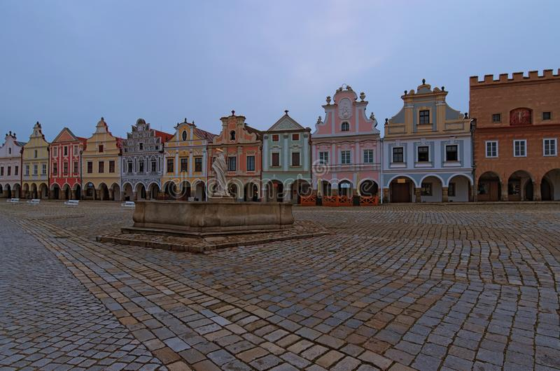 Scenic morning view of main square in medieval Telc. Fountain with statue of st. Margaret and colorful vintage buildings. A UNESCO world heritage site. Telc royalty free stock images
