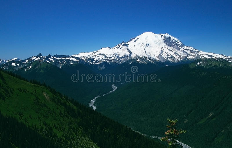 Scenic Mount Rainier in Washington state. Mt. Rainier is 14412ft tall and is a dormant volcano. It is continually snowcapped and is one of the most popular stock photo