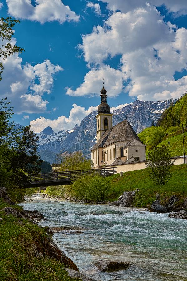 Scenic mountain landscape in the Bavarian Alps with famous Parish Church of St. Sebastian in the village of Ramsau royalty free stock photos