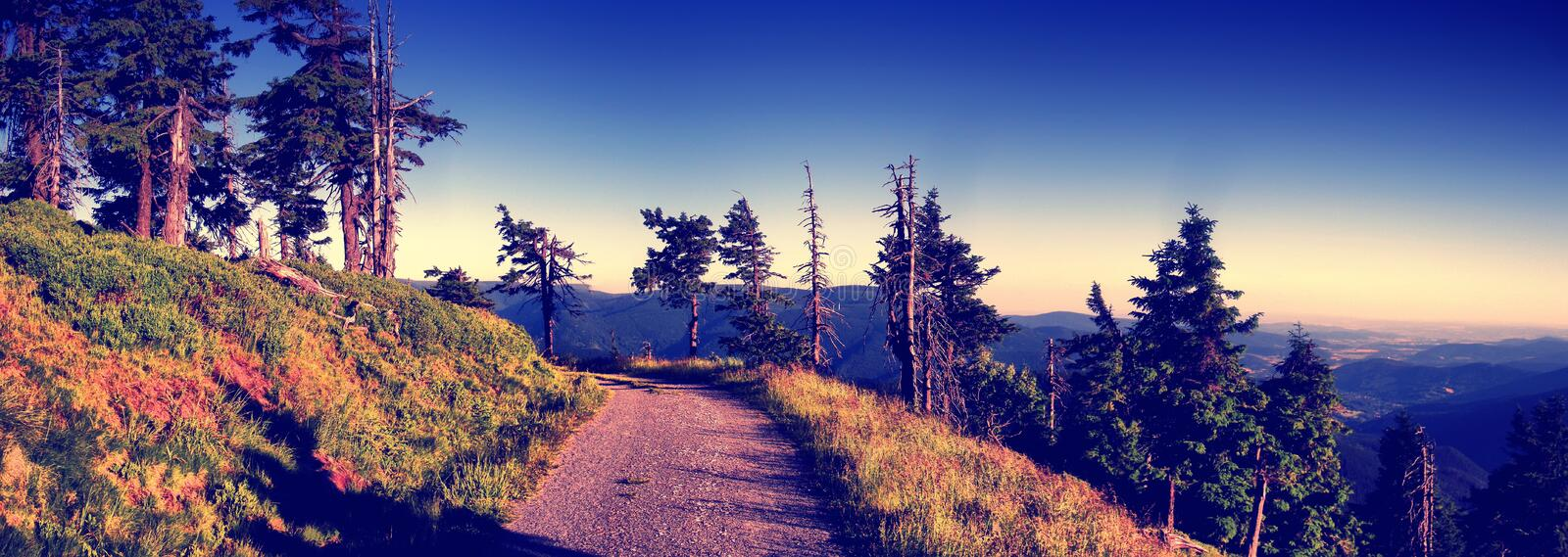 Scenic mountain landscape with gravel road royalty free stock photos