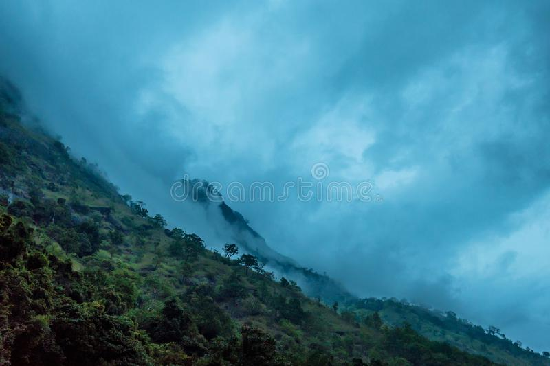 Scenic mountain landscape on Sri Lanka. Srilankan landscape with tropical mountain forest covered with misty clouds royalty free stock photo