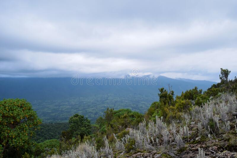 Scenic Mountain landscapes against sky. Panoramic mountain landscapes in rural Kenya, Mount Suswa, Rift Valley, Kenya royalty free stock photo