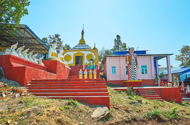Nat Shrines in Popa, Myanmar. The scenic Nat shrines at the Popa Taung Kalat monastery with many statues, Buddha images and decorated buildings, Myanmar stock photo
