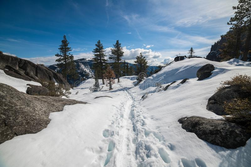 Scenic nature mountain view hiking trail under snow at winter time. stock photo