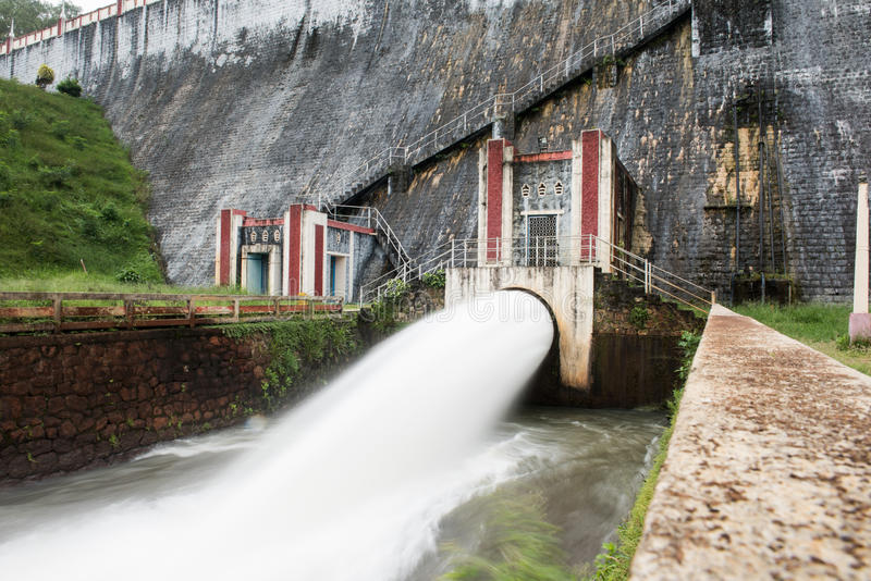 Scenic Neyyar Gravity Dam. Water rushing with speed through the water gates in Neyyar dam at Thiruvananthapuram, Kerala. Neyyar is a gravity dam with astonishing stock images