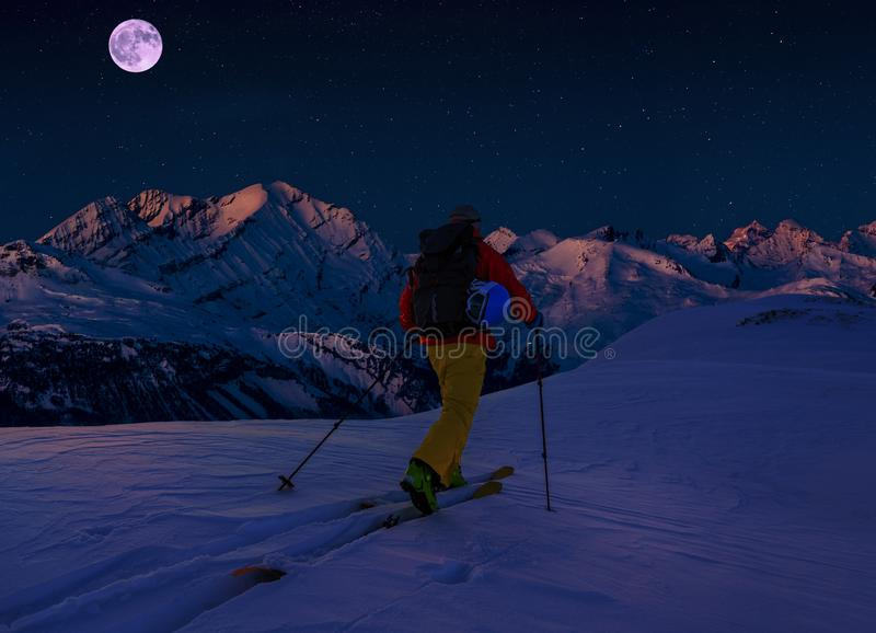 Scenic night backcountry ski panorama sunset landscape of Crans-Montana range in Swiss Alps mountains with peak in background, stock images