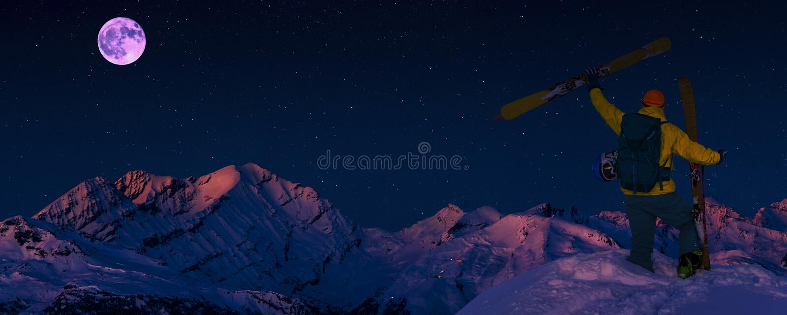 Scenic night backcountry ski panorama sunset landscape of Crans-Montana range in Swiss Alps mountains with peak in background, stock image