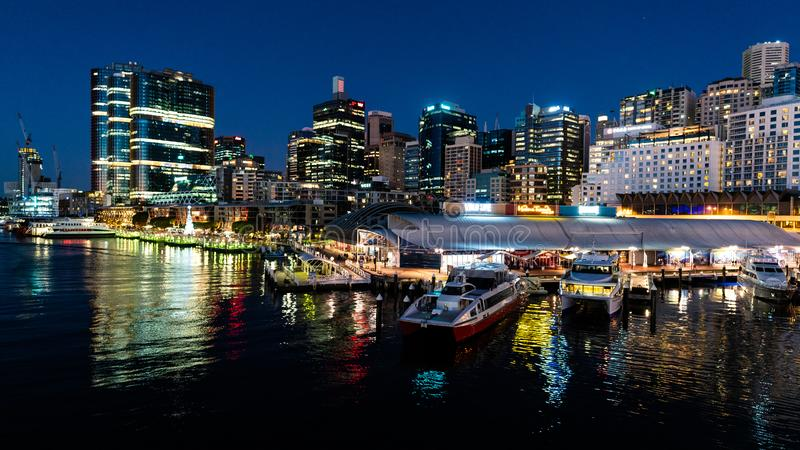 Scenic night view of Sydney Darling Harbour with King street wharf and marina royalty free stock image