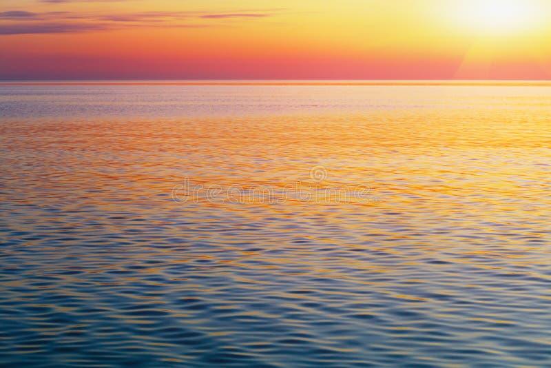 Scenic ocean landscape. Golden sunset or sunrise at sea stock image
