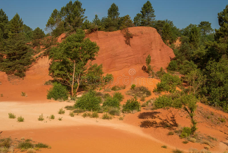 Scenic ocher Colorado Provencal canyon in Provence region of France. Scenic and colorful ocher Colorado Provencal sand canyon in Provence region of France royalty free stock images