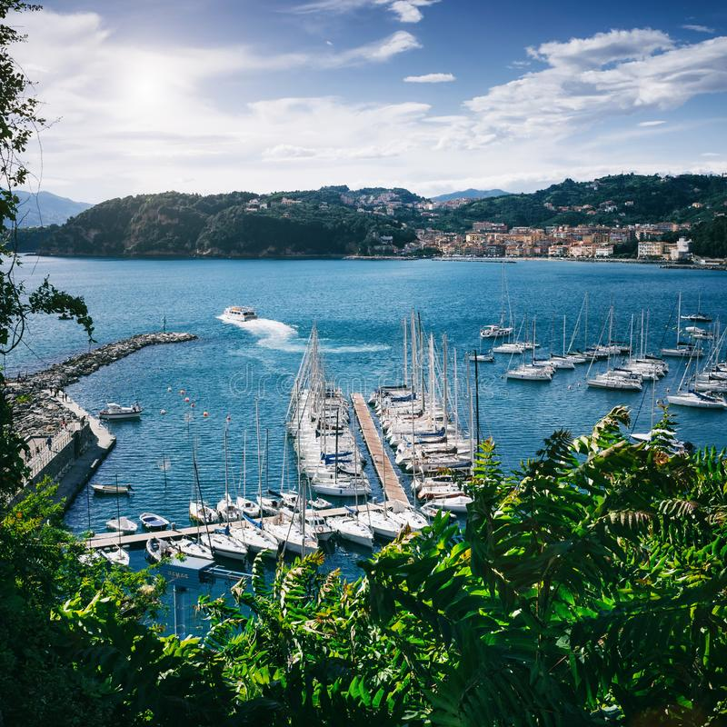 Scenic overview of white sailing boats, moored in harbour port of Lerici, Liguria, Italy. Picturesque travel destination postcard stock images