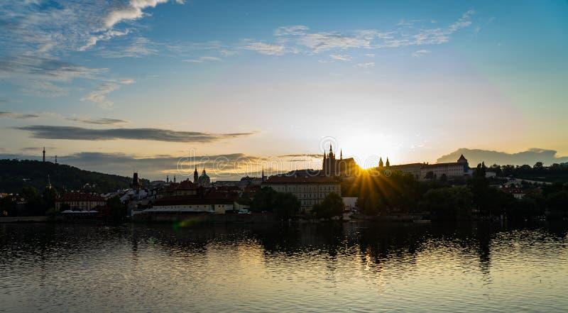 Scenic panorama cityscape view of Moldava river boat Prague in Czech Republic. Scenic panorama cityscape view of Moldava river boat Prague in Czech Republic stock images