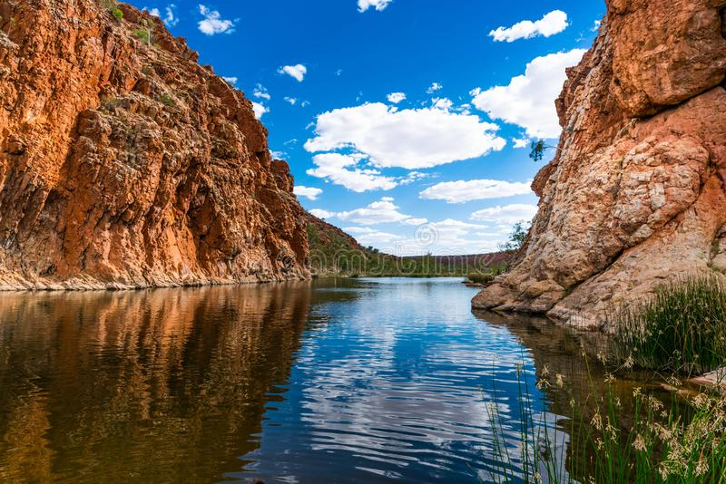 Scenic panorama of Glen Helen gorge in West MacDonnell National Park in central outback Australia. Scenic panorama of Glen Helen gorge in West MacDonnell stock image