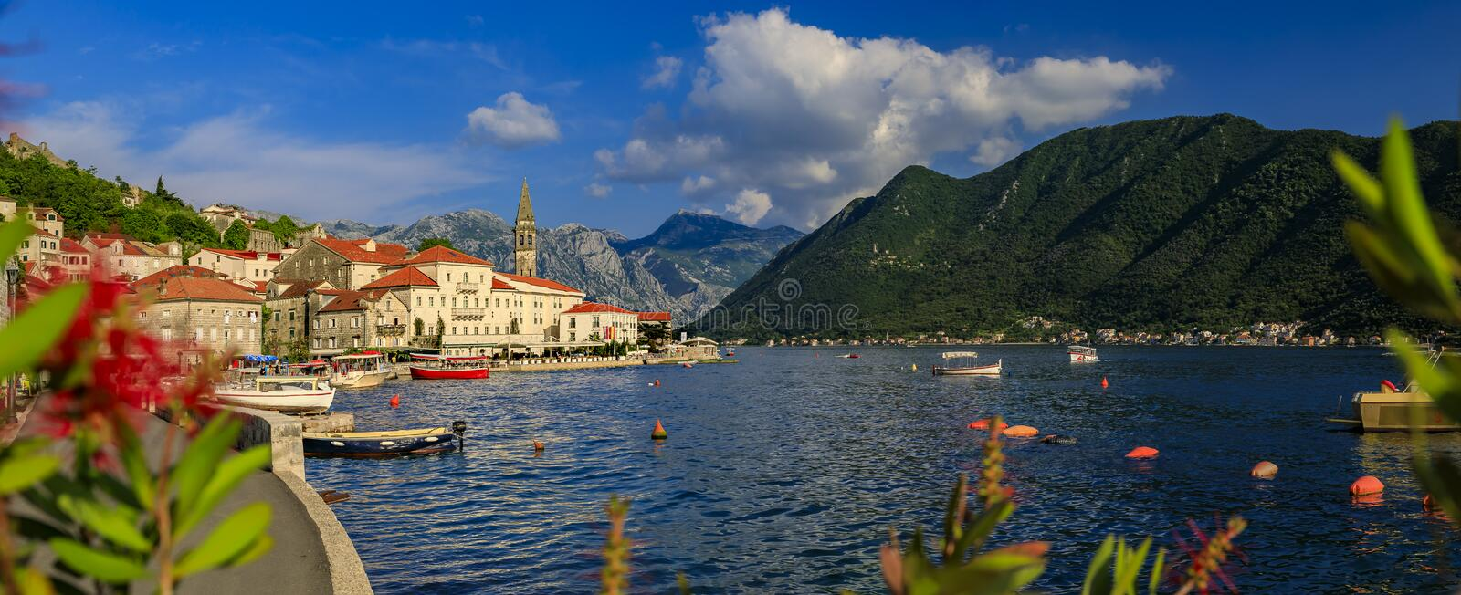 Scenic panorama of the postcard perfect historic town of Perast in Kotor Bay on a sunny day in the summer, Montenegro. Scenic panorama of a postcard perfect stock image