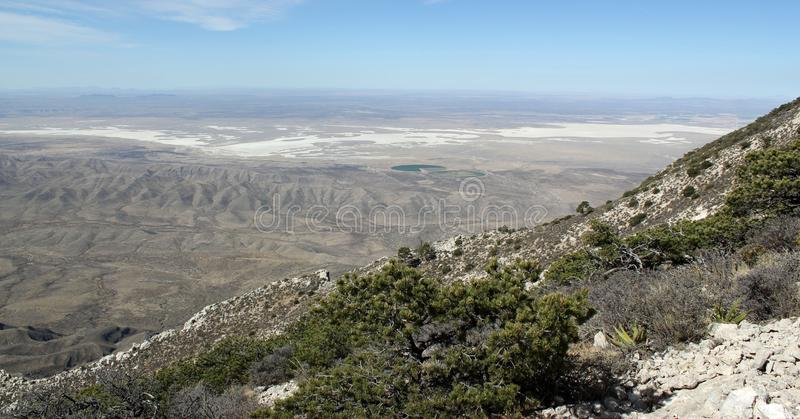 Scenic panoramic view from Guadalupe Peak into the wide texas landscape. Beautiful landscape / distinctive mountains and dry deserts in Big Bend Nationalpark / stock photo