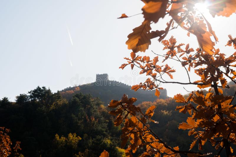 Scenic panoramic view of a hill with a portion of the Great Wall close to Jinshanling, on a sunny day of autumn, in China, fall stock photo