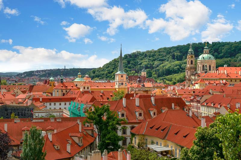 Scenic panoramic view of roofs and historical center of Prague, Czech Republic on a cloudy sunny day stock images