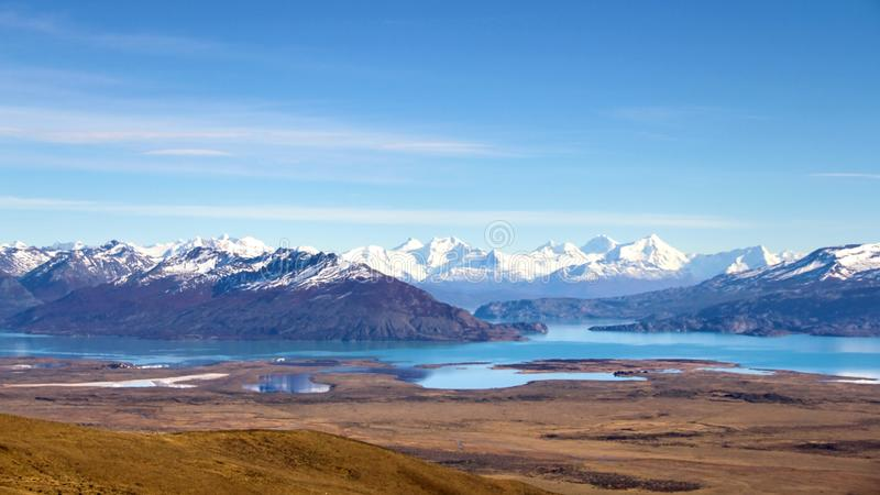 Scenic panoramic view to beautiful valley with turquoise lakes with snow-capped mountains on background in Los Glaciares national stock photo