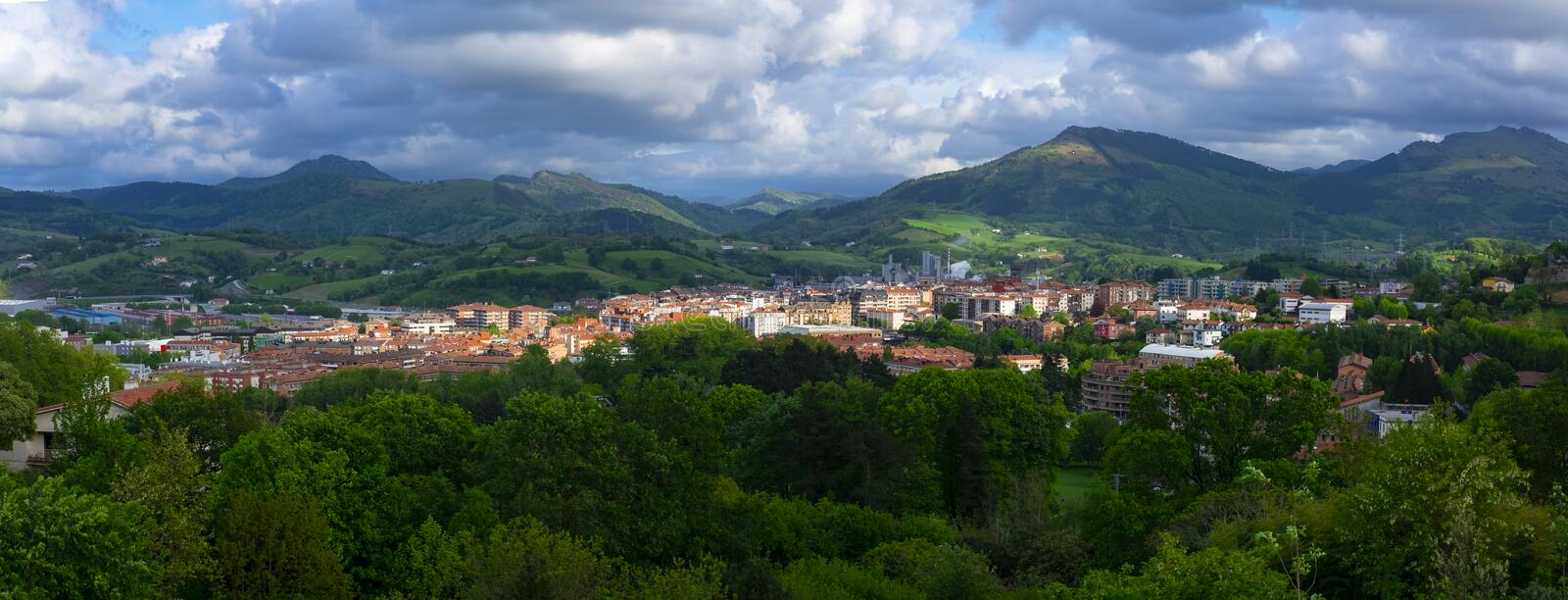 Scenic panoramic view of a village in mountain valley at sunset. Colourful countryside landscape with mountain. Hernani Basque Country royalty free stock image