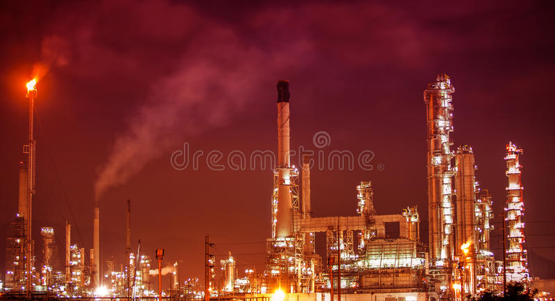 Petrochemical oil refinery plant. Scenic of petrochemical oil refinery plant shines at night royalty free stock photos