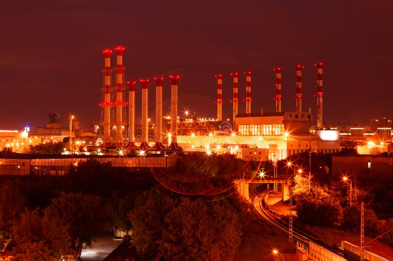 Scenic of petrochemical oil refinery plant shines at night. Scenic of petrochemical oil refinery plant shines at night, factory pipes in night lights stock photo