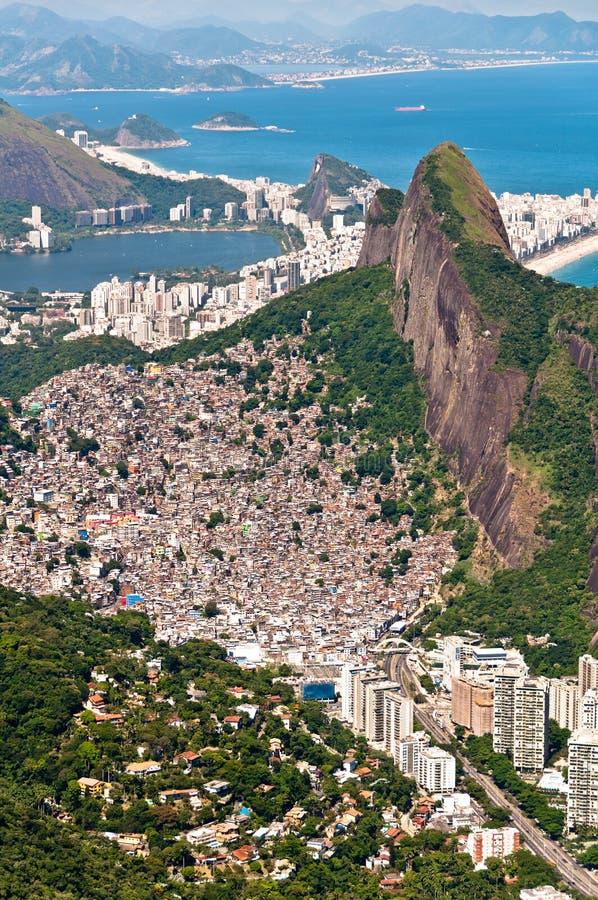 Scenic Rio de Janeiro Aerial View. Aerial view of Favela da Rocinha, biggest slum in Brazil on the mountain in Rio de Janeiro, and skyline of the city behind royalty free stock photo