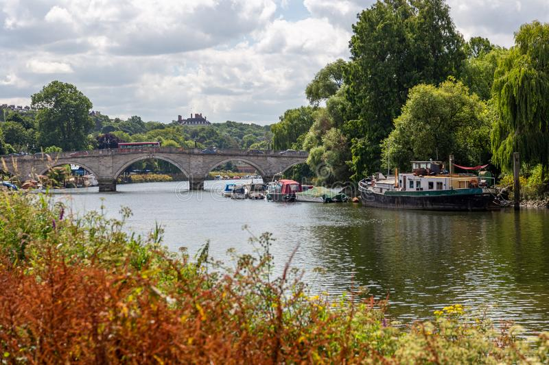 Scenic riverside view of the River Thames and Richmond Bridge royalty free stock photo