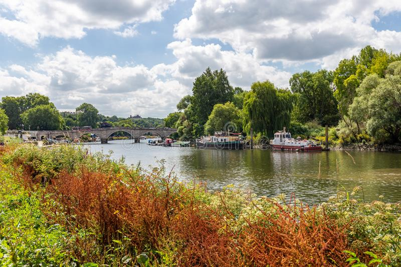 Scenic riverside view of the River Thames and Richmond Bridge stock photography