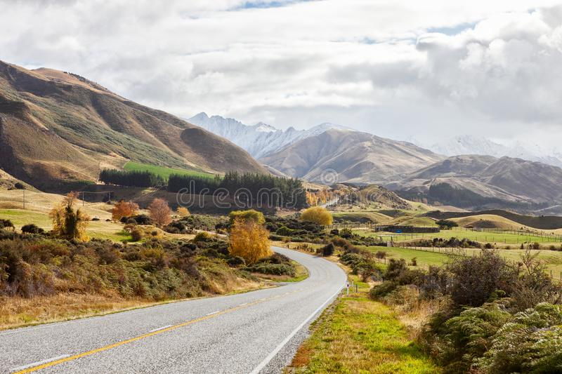 Scenic Road along Lake Hawea at autumn day, South Island, New Zealand royalty free stock image