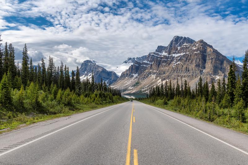 Scenic road in the Canadian Rockies. Road trip. Scenic road in the Canadian Rockies at sunny summer day, Icefields Parkway, Banff National Park, Alberta, Canada royalty free stock images