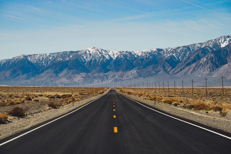 Scenic Road Running Through the Desert. Death Valley, American Southwest royalty free stock images