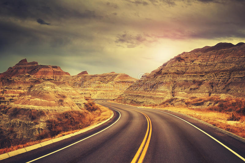 Scenic road at sunset, color toned picture. stock photo