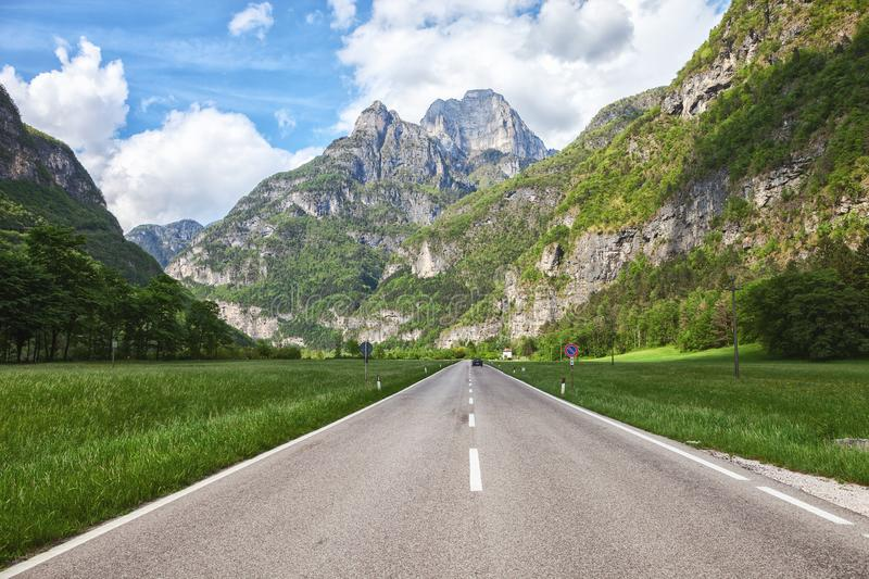 Scenic road through the valley of Dolomite mountains, Italy royalty free stock photo