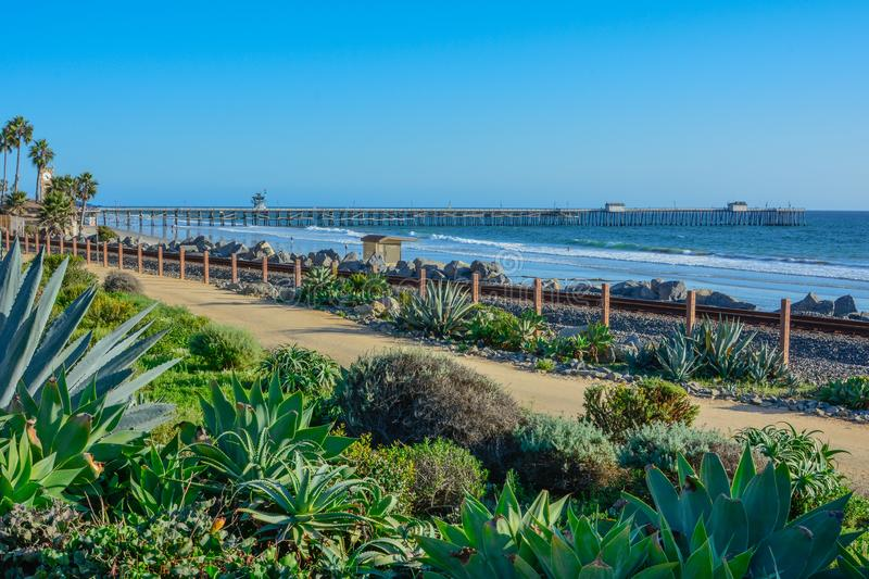 Scenic San Clemente Ocean side close to pier and rails pacific surfliner stock photo