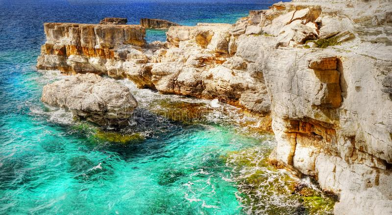 Greek Islands, Sea Cliffs, Coast Landscape, Beaches. Scenic sea cliffs, coast landscape and beaches, Greek Islands. Cyclades - Greece. Europe royalty free stock image