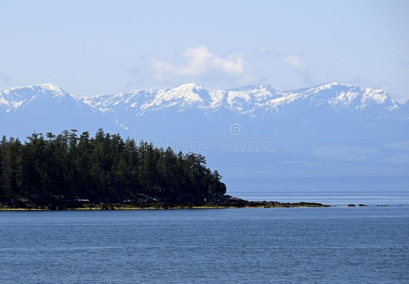 Blubber Bay and Vancouver Island Mountain ranges. Scenic seascape along the shoreline of the Texada Island near Blubber Bay, Vancouver Island Mountain ranges in royalty free stock photos