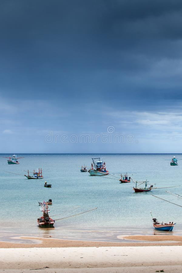 Scenic seascape fisherman life, a lot of traditional fishing wooden boat in the sea, storm is coming backgrounds, sand beach. Scenic seascape fisherman life, a stock photos
