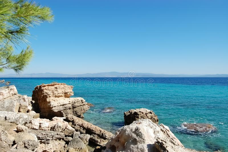 Scenic seascape with stone coast and turquoise sea in Greece royalty free stock photo
