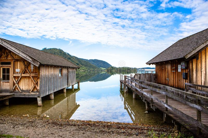 Scenic seaside of lake Schliersee on a sunny day with blue sky in Bavaria, Germany royalty free stock photos