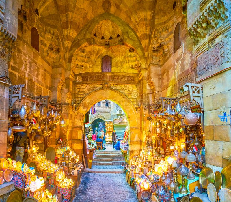 The scenic shop in Khan El-Khalili market, Cairo, Egypt. CAIRO, EGYPT - DECEMBER 20, 2017: The Bab al-Ghuri gates with its Arabian lamps shop is one of the most stock image