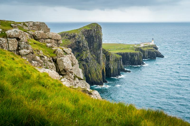 Scenic sight of Neist Point Lighthouse and cliffs in the Isle of Skye, Scotland. stock photo