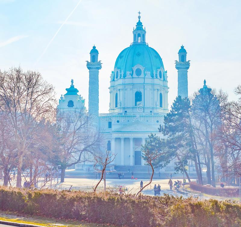 Karlskirche in morning haze, Vienna, Austria. The scenic silouhette of the Karlskirche with two columns, located next to small Resselpark in the center of Vienna royalty free stock photos