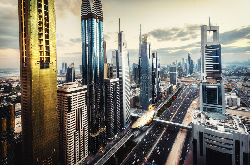 Scenic skyline of a big futuristic city with world tallest skyscrapers. Aerial view over downtown Dubai, UAE. Artistic travel and architectural background stock images