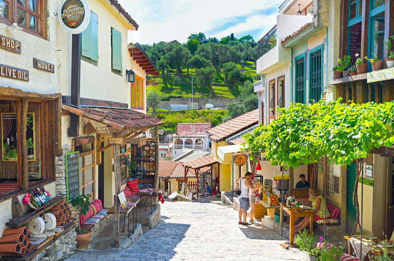 The scenic street. STARI BAR, MONTENEGRO - JULY 14, 2014: The narrow tourist street with the souvenir market, numerous cafes and restaurants, on July 14 in Stari royalty free stock images