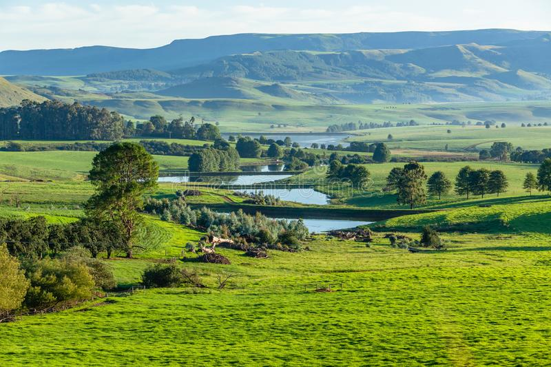 Farmlands Mountains Water Catchment Dams Summer. Scenic summer mountain farmlands with water catchment dams down the green landscape terrain stock photography